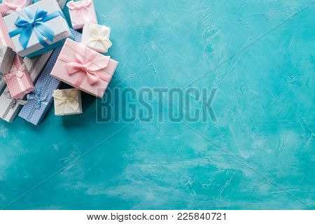 Assortment Of Gift Boxes On Blue Background. Consumerism Sale Discount. Present Shopping. Holiday Fe