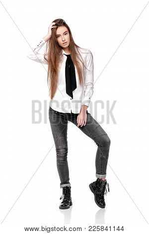 Concerned Woman With Long Hair In White Shirt And Tie Isolated On White Background
