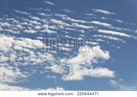 White And Fluffy Summer Clouds Against The Blue Clear Sky.