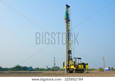 Close-up Pile Driver Working In Construction Site