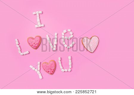 Marshmallows On Pink Background With Sign In English I Love You. Flat Lay Or Top View. Background Or