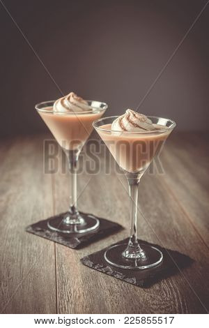 Two Irish cream liqueurs with a swirl of cream