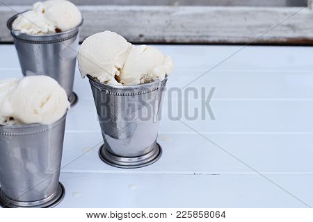 Frosty Metal Cups Filled With Scoops Of Creamy Vanilla Ice Cream.