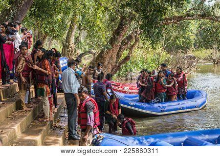 Coorg, India - October 29, 2013: Water Rafting In Kaveri River. Dinghy Sloops Land At Stairway On Sh