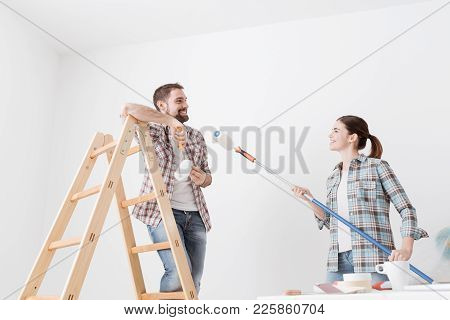 Playful Couple Painting Walls