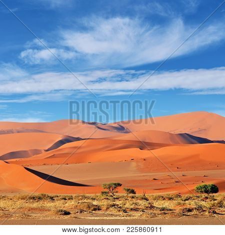Beautiful Landscape With Big Red Dunes And Cloudy Sky At Sunrise, Sossusvlei, Namib Naukluft Nationa