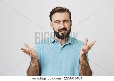 Attractive Adult Man With Beard And Moustache, Raising Hands In Frustrated Gesture Feeling Unsure In