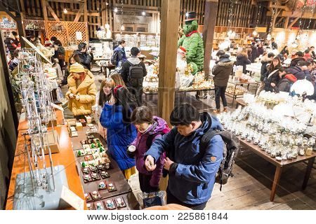 Otaru, Japan, January 28, 2018: Shoppers And Tourist Shopping For Music Boxes At The Popular Music B