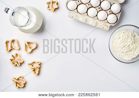 Wheat Flour In The Glass Bowl, Cream In A Glass Jar, Chicken Eggs - Ingredients For The Dough, On A