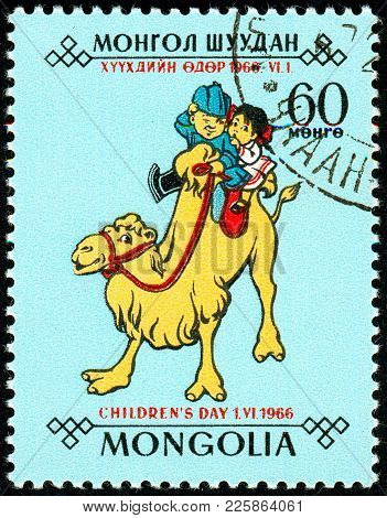 Ukraine - Circa 2018: A Postage Stamp Printed In Mongolia Shows Children, A Boy And A Girl Ride On A