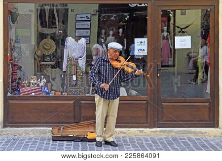 Brasov, Romania - July 25, 2017: Street Musician Is Playing Violin Outdoor In Brasov, Romania