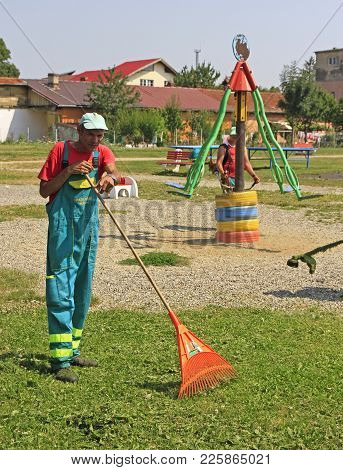 Brasov, Romania - July 25, 2017: Street Cleaner Is Doing His Work Outdoor In Brasov, Romania