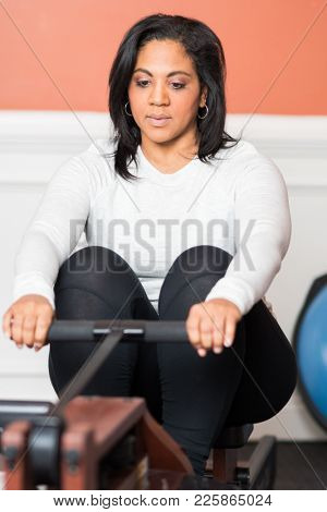 Woman working out in a gym at home