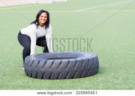 Woman at a boot camp exercise class outside