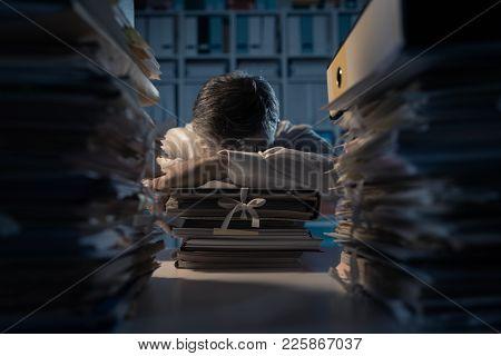 Office Worker Sleeping On The Desk