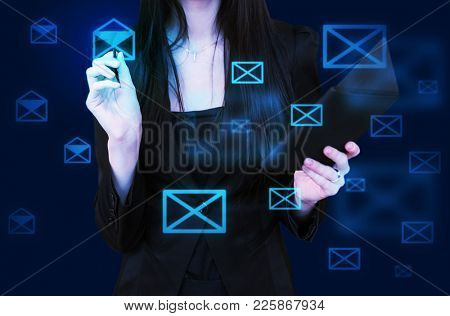 Girl with a tablet in her hand sequentially opens a letter in an email