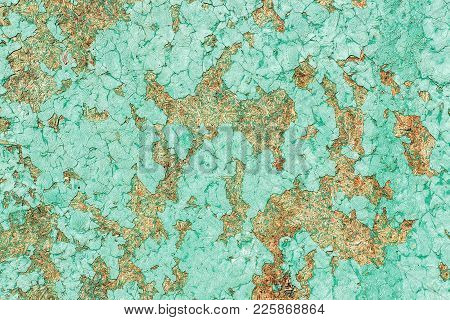 Old wooden surface (compressed sawdust ) with cracks and peeling paint green. texture, background.