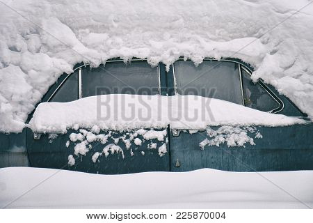 Old Russian Soviet Car Buried Under The Snow After A Snow Storm. Side View.