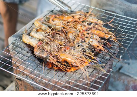 Grilled Prawns,grilled Shrimp On Grill With Stove In Background.