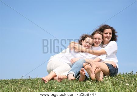 Three Girlfriends In White T-Shorts Embrace