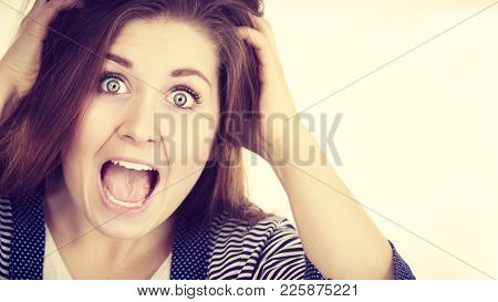 Attractive Woman With Dark Brown Hair Having Shocked Amazed Face Expression With Wide Open Mouth Tou