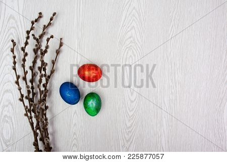 Easter Background. Pussy Willow Branches And Woman Hand With Eggs.