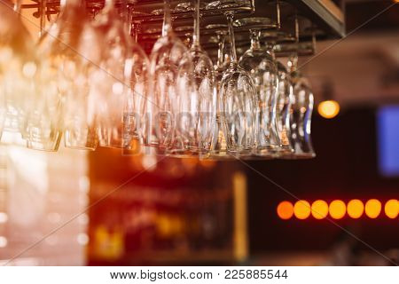 Wine Glasses For Wine Above The Bar Counter Blured Toned Photo