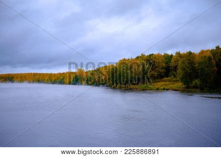 River Through An Autumn Forest. Beautiful Views Of Autumn Landscape - The River Flows Through The Au