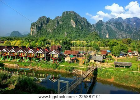 Row Of Tourist Bungalows Along Nam Song River In Vang Vieng, Vientiane Province, Laos. Vang Vieng Is