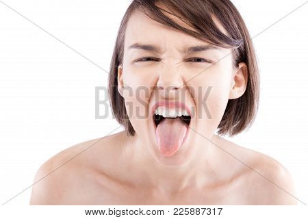 Beautiful Girl Making Expression And Thrusting Her Tongue Out