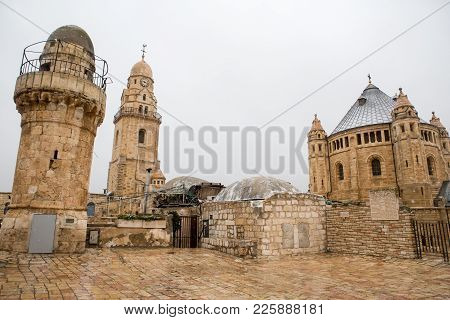 Jerusalem Old City Mosque Roof And A Curch During A Snow