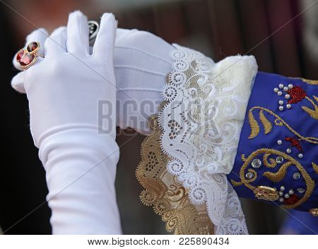 Hand Of Man And Woman With White Gloves