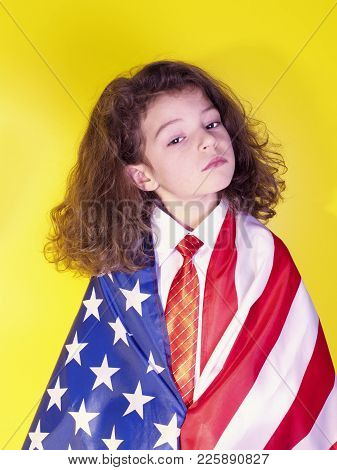 Cheerful Little Boy With The Flag Of The United States