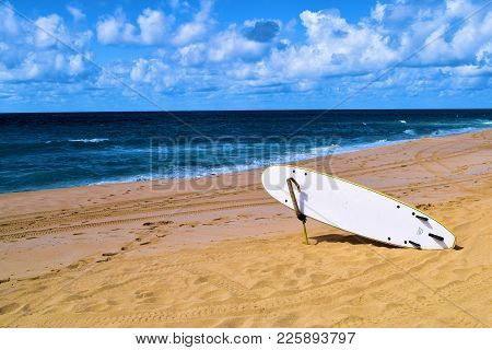 January 30, 2018 At Makaha Beach In Oahu, Hi:  Lone Surf Board Ready To Be Used For Surfing Taken At