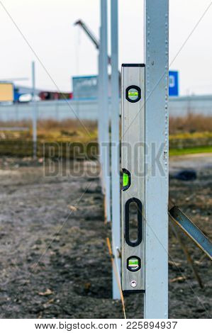 Magnet Water Bubble Level Gauge On Steel Beam At Construction Site For Measuring, Check Level Of The