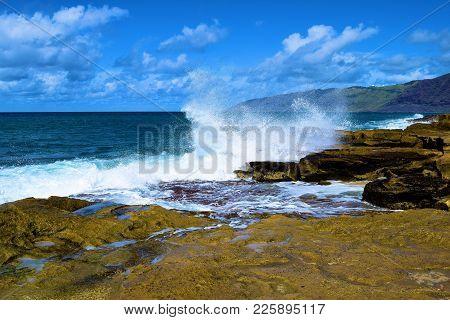 Waves Crashing Onto Tide Pools On A Rocky Coastline During High Tide Taken In Rural Oahu, Hi