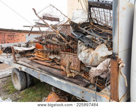 Fully Loaded Truck With Metal Scrap Metal Parts. Loading Scrap In Truck.