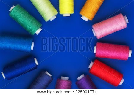 Background With Colored Sewing Thread Red Blue