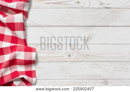 table with red picnic cloth top view background