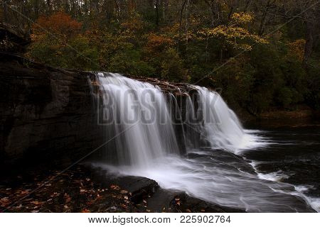 Water Gushes Over Hooker Falls In The Mountains Of Southern North Carolina Near The City Of Brevard