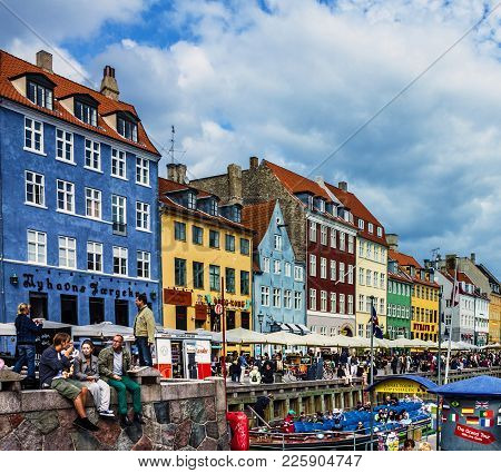 Copenhagen, Denmark - May 3, 2017: Seafront Nyhavn And Tourists In Copenhagen, Denmark