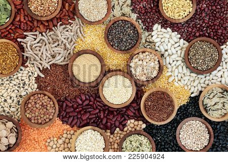 Dried health food background with smart carbsohydrates of pulses, grains, seeds and cereals. Super foods high in vitamins, antioxidants, omega 3, anthocyanins, minerals and fibre. Top view.