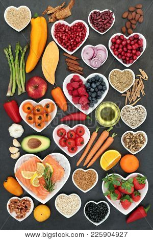 Food for a healthy heart with fruit, vegetables, fish, nuts, seeds, pulses, cereal, medicinal spices and herbs. Super food very high in omega 3, antioxidants, anthocyanins, fibre and vitamins.