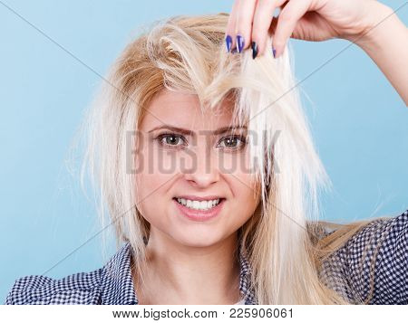Haircare And Hairstyling, Bad Effects Of Bleaching Concept. Blonde Woman Holding Her Damaged, Split