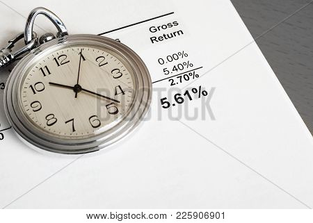 Investment Report Showing Moderate Return, And A Silver Pocket Watch. Concepts Of Investing For The