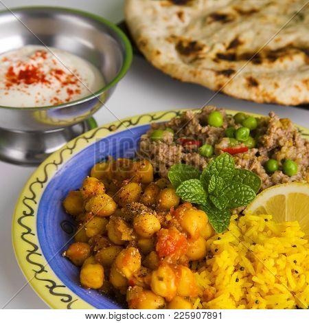Indian Meal Of Keema Matar, Masala Channa, Lemon Rice, Naan Bread And Yoghourt, Which Is Minced Lamb