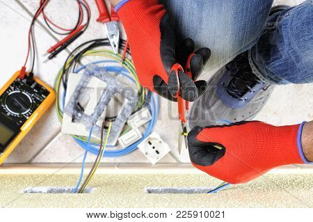 Electrician Technician At Work With Scissors On Cable In A Residential Electrical Installation