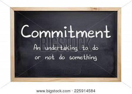 Commitment Concept - A Blackboard With The Words Commitment, An Undertaking To Do Or Not Do Somethin