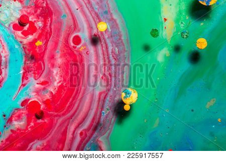 Abstract colorful background. Liquid color ink in water. Fabulous shapes.
