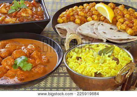 A Sekection If Indian Foods, Or A Banquet, With Pillau Rice, Chapatis, Channa Dhal, Chicken Jalfrezi